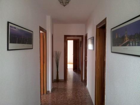pasillo de la planta superior entre dormitorios rurales