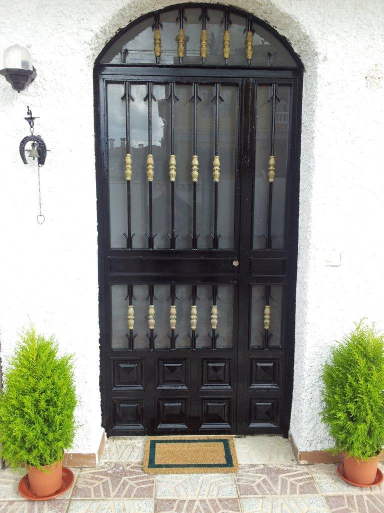 Puertas para entrada principal de casas 16 bilder car for Puertas de casa